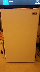 White RCA Mini fridge- new condition **moving sale**