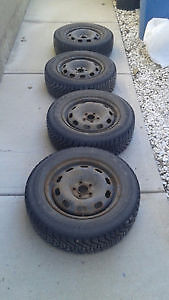 four goodyear nordic P195/65R15 WINTER tires ON RIMS