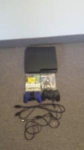 Sony PS3 with 2 Games and 2 Wireless Controllers