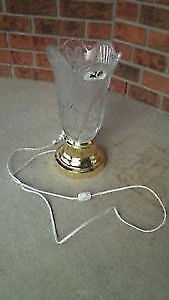 Cut glass lamp with brass coloured base