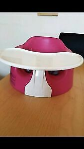 pink baby bumbo chair with tray and straps
