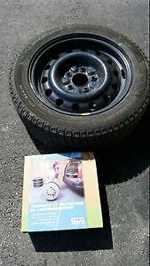 Winter tire Michelin X-Ice Xi 3 on steel rim
