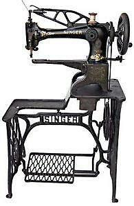 antique singer sewing machine with knee pedal