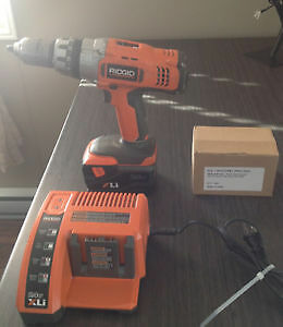 Ridged 24 Volt Lithium Ion drill with two new batteries