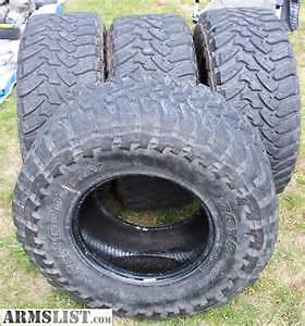4   LT 35X12.50X18 TOYO OPEN COUNTRY MT 10 PLY  TIRES