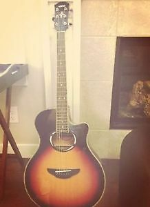 Yamaha electro acoustic guitar with its cable