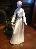 DISCONTINUED ROYAL DOULTON RELECTION  FIGURINE   DEMURE. HN 3045