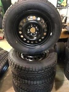 WINTER TIRES AND RIMS AVALANCHE 225/70 R 16 LIKE NEW,