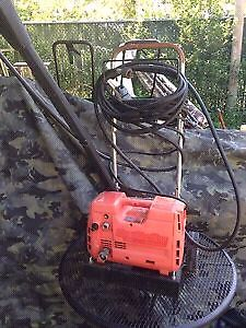 Coleman Clean machine 1300 PSI electric power washer.