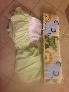Jungle theme crib bumper pad with matching polka dot skirt