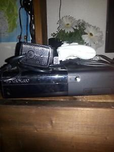 NEWEST XBOX 360 SLIM WITH GAMES.