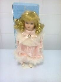 porcelain doll name Victoria approx 11 inch on a stand in a box