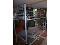 Metal framed bunk beds,with mattresses. Shorty type, smaller bunk bed.