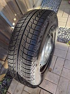195/65R15 Michelin X-Ice on steel wheels for a 2013 Chev Sonic. $104.95 each (75% tread).