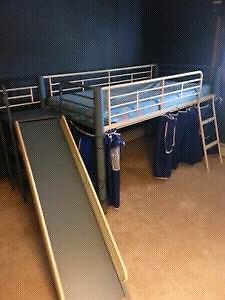 Loft bed with slide and shelves