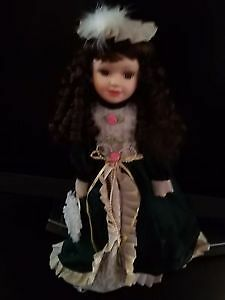 Beautiful Porcelain Doll 16 inch tall.