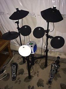 Drum batterie electronique tout inclut prof de drum 380$.