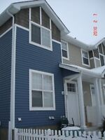 Newer townhouse with double garage for rent in The Hamptons