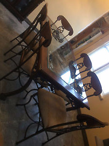 Beautiful large glass and rod iron diningroom table