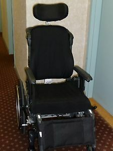 Reclining wheelchair with headrest almost new