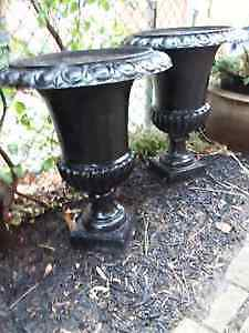 Two Cast Iron Urns