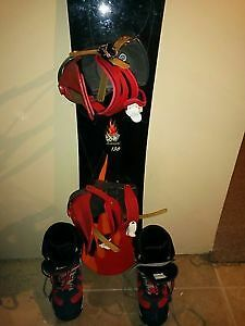Liquid 138 snowboard with size 8 womans boots/fits boys size 6