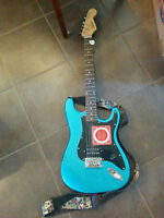 Squier Bullet by Fender, blue. With accessories & amp. $200 OBO