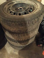 Winter tires Michelin x Ice 2 185/65/15 on steel rims & hubcaps