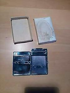 Vintage stainless steel cigarette case with integrated lighter