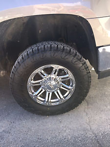 LT265/70R17 Toyo Open Country CT tires on 17 inch chrome rims