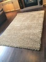 Brand new Beige shag rug from Costco. Made in Belgium. $100 FIRM