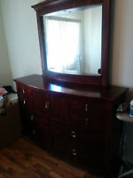 Elegant full-size brown dresser with matching mirror for sale!