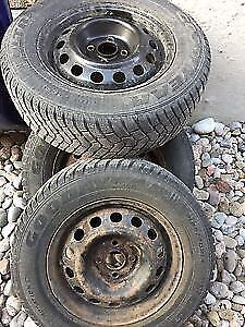 4 Used Goodyear Ultra grip Snow tires And on steel rims. L@@K