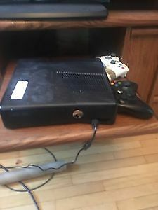 Black Xbox 360 with two controllers one charge pack and cable