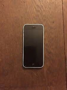 White iPhone 5C with Otterbox Case (bell)