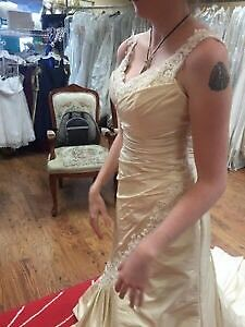 New never worn size 4-6 champagne wedding dress