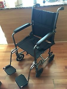 new Transport Wheelchair easy to fold - comes with foot-rest