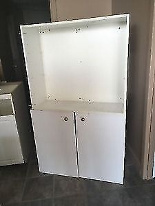 Various white cabinetry pieces/storage room shelves