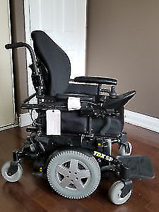 electric wheelchair The Invacare TDX SP like new T.647-781-8987