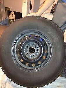 Four Firestone Winterforce Tires and Rims p245/75r16