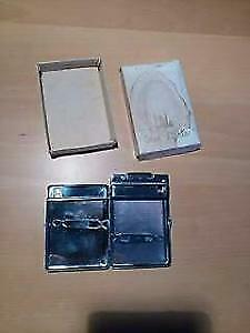 Vintage cigarette case with integrated lighter