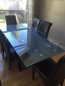 Glass & dark wood dining table