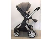 Stokke Crusi stroller + bassinet bed, sleeping bag, car seat (+ISOFIX base) + travel bag, cost £1800