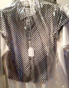 CLOTHS BRAND NEW $10 EACH RETAIL$32.99-49.99 PLUS TAX