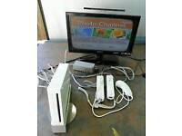 Nintendo wii console/ 2 wii remotes/ 1 top game / cash or swaps