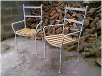 lovely quality heavy cast iron garden chairs.. with wooden seats