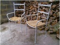lovely quality solid heavy cast iron garden chairs.. with wooden seats