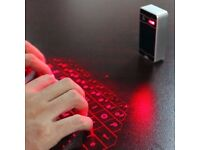 Bluetooth laser keyboard projector (also a speaker(can be linked to smart phone, tablet)