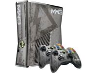 Xbox 360 and 7 games, Modern Warfare 3 Console, 2 x MW3 Controllers & wireless charger station.