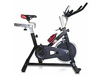 MODEL- XS Sports Aerobic Indoor Training Exercise Bike-15kg Chain driven Flywheel, Padded Armrests,